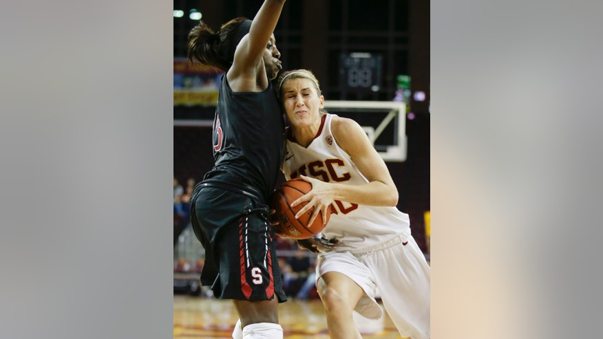 Southern California forward Christina Marinacci, right, tries to drive around Stanford forward Chiney Ogwumike during the second half of an NCAA women's basketball game in Los Angeles, Friday, Feb. 15, 2013. Stanford defeated Southern California 79-55 (AP Photo/Chris Carlson)
