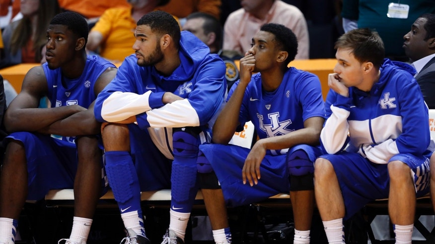 Kentucky player's look on in the final minutes of the second half of an NCAA college basketball game against Tennessee on Saturday, Feb. 16, 2013, in Knoxville, Tenn. Tennessee won 88-58. (AP Photo/WADE PAYNE)