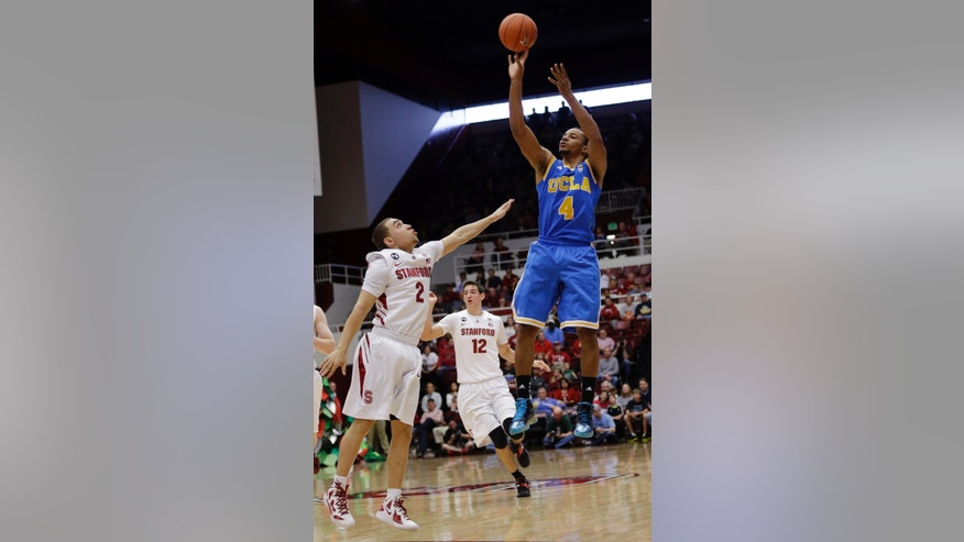 UCLA's Norman Powell (4) shoots over Stanford's Aaron Bright (2) during the first half of an NCAA college basketball game in Stanford, Calif., Saturday, Feb. 16, 2013. (AP Photo/Marcio Jose Sanchez)