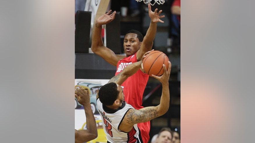 San Diego State's Skylar Spencer, right, reaches to block a shot by UNLV's Anthony Marshall in the first half an NCAA college basketball game, Saturday, Feb. 16, 2013, in Las Vegas. (AP Photo/Julie Jacobson)