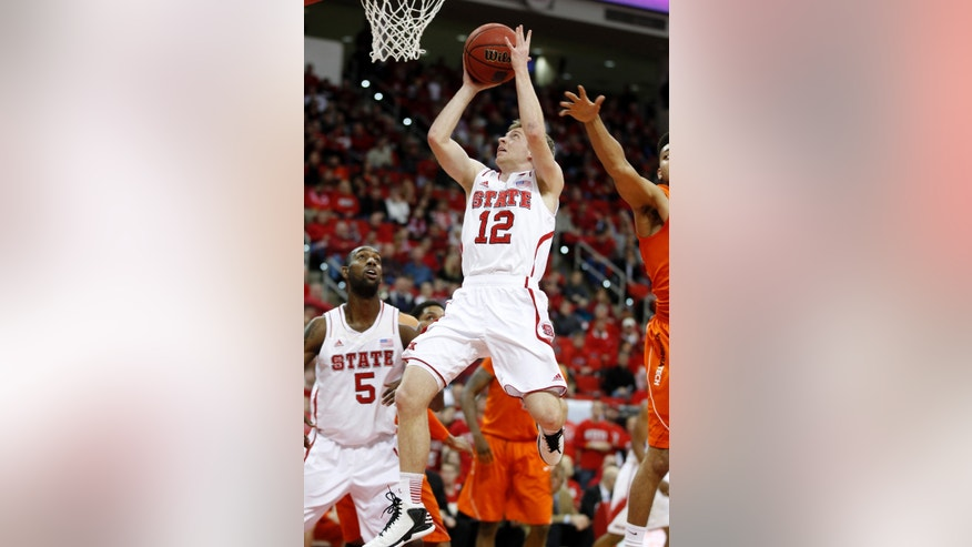 N.C. State's Tyler Lewis (12) shoots during the first half against Virginia Tech in an NCAA college basketball game in Raleigh, N.C., Saturday, Feb. 16, 2013. (AP Photo/The News & Observer, Ethan Hyman)  Mandatory Credit