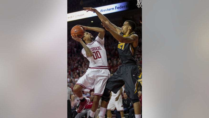 Arkansas' Rashad Madden (00) pulls up for a shot against Missouri's Laurence Bowers (21) during the first half an NCAA college basketball game in Fayetteville, Ark., Saturday Feb. 16, 2013. (AP Photo/Gareth Patterson)
