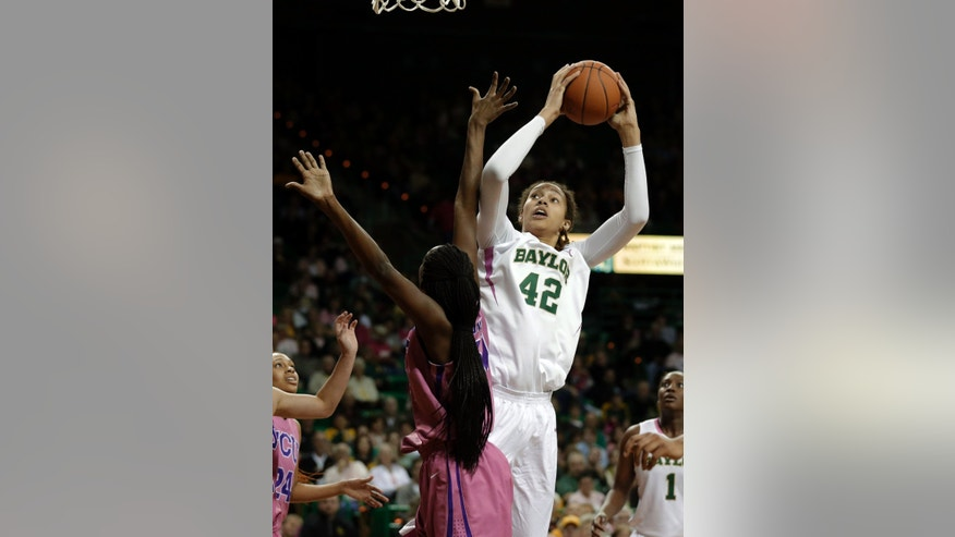 Baylor 's Brittney Griner (42) goes up for a score over TCU 's Latricia Lovings (21) in the second half of an NCAA college basketball game Saturday, Feb. 16, 2013, in Waco, Texas. Griner had 22-points in the 78-45 Baylor win. (AP Photo/Tony Gutierrez)