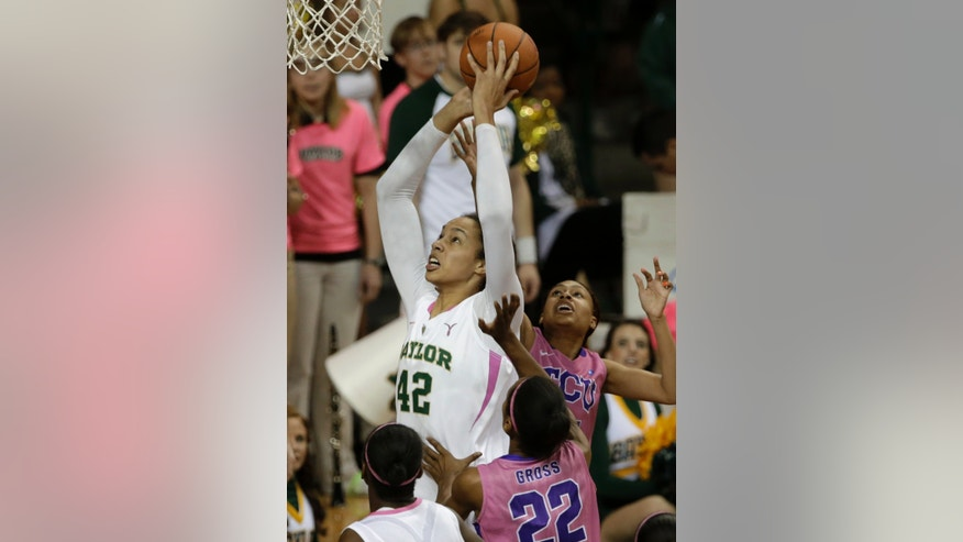 Baylor 's Brittney Griner (42) goes up for a score over TCU 's Delisa Gross (22) and Ashley Colbert, rear, in the first half of an NCAA college basketball game Saturday, Feb. 16, 2013, in Waco, Texas. (AP Photo/Tony Gutierrez)