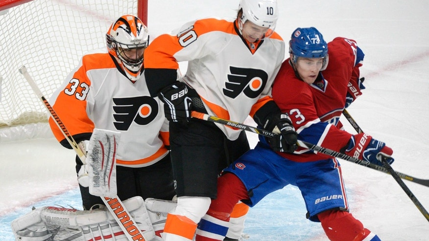 Montreal Canadiens' Brendan Gallagher, right, pressures Philadelphia Flyers' goalie Brian Boucher as Flyers' Brayden Schenn (10) defends during the first period of an NHL hockey game in Montreal, on Saturday, Feb. 16, 2013. (AP Photo/The Canadian Press, Graham Hughes)