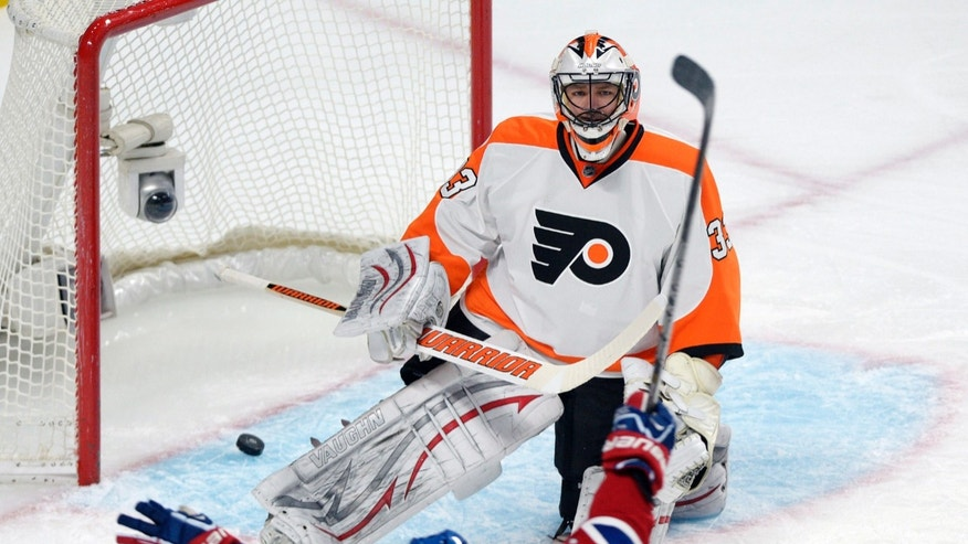 Montreal Canadiens' Brendan Gallagher scores against Philadelphia Flyers goalie Brian Boucher during the first period of an NHL hockey game in Montreal, on Saturday, Feb. 16, 2013. (AP Photo/The Canadian Press, Graham Hughes)