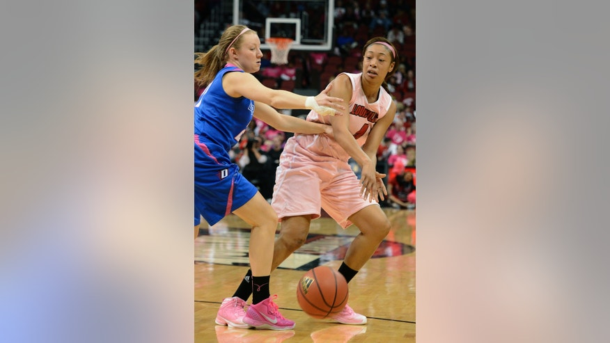 Louisville's Antonita Slaughter, right, passes around the defensive pressure of DePaul's Megan Rogowski during second-half action of their NCAA college basketball game on Sunday, Feb. 17, 2013, in Louisville, Ky. Louisville defeated DePaul 81-55. (AP Photo/Timothy D. Easley)