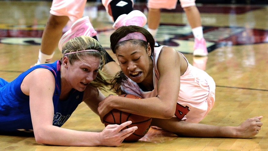Louisville's Antonita Slaughter, right, battles DePaul's Megan Podkowa for a loose ball during the second half of their NCAA college basketball game, Sunday, Feb. 17, 2013, in Louisville, Ky. Louisville won 81-55. (AP Photo/Timothy D. Easley)