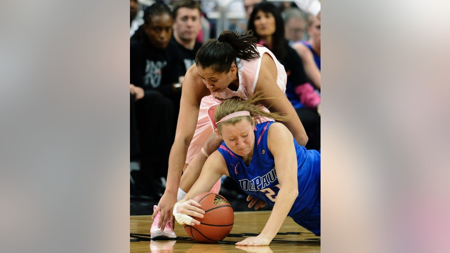 Louisville's Shoni Schimmel, top, battles DePaul's Megan Rogowski for a loose ball during the second half of their NCAA college basketball game, Sunday, Feb. 17, 2013, in Louisville, Ky. Louisville won 81-55. (AP Photo/Timothy D. Easley)