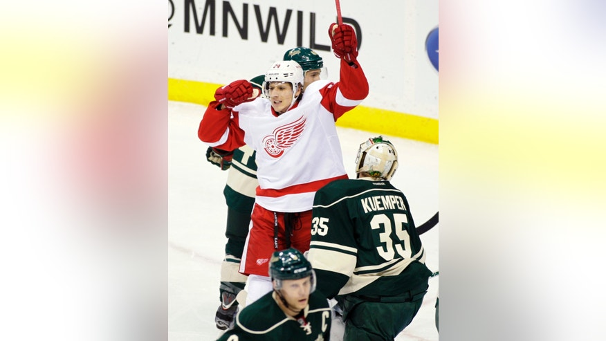 Detroit Red Wings center Damien Brunner (24) celebrates his first-period goal against Minnesota Wild goalie Darcy Kuemper (35) during an NHL hockey game, Sunday, Feb. 17, 2013, in St. Paul. (AP Photo/Paul Battaglia)