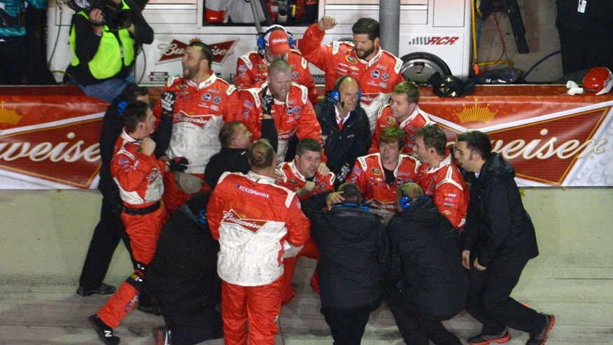 Kevin Harvick's crew members gather on pit row after Harvick won the NASCAR Sprint Unlimited auto race at Daytona International Speedway in Daytona Beach, Fla., Saturday, Feb. 16, 2013. (AP Photo/Phelan M. Ebenhack)