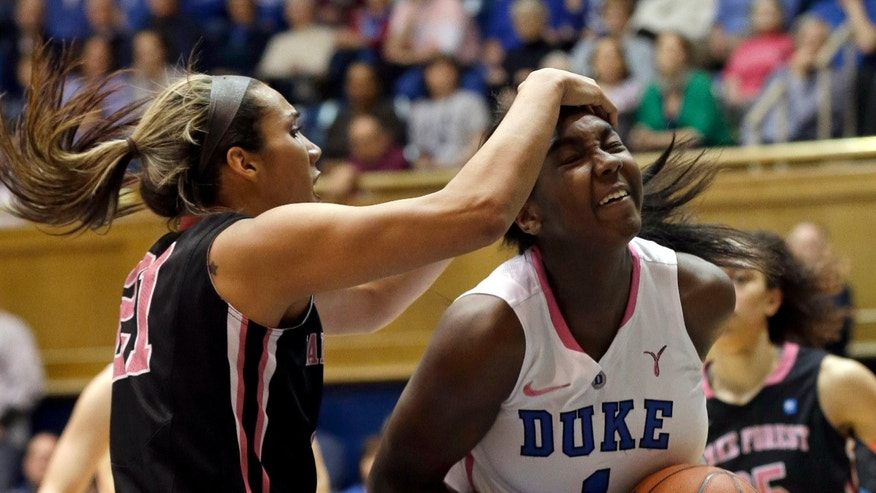 Wake Forest's Sandra Garcia, left, grabs Duke's Elizabeth Williams (1) during the first half of an NCAA college basketball game in Durham, N.C., Sunday, Feb. 17, 2013. (AP Photo/Gerry Broome)