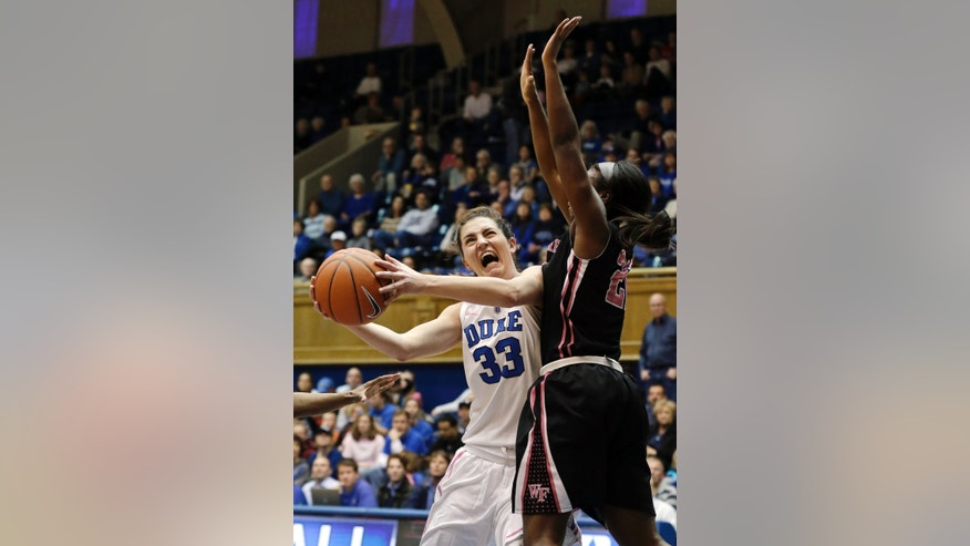 Duke's Haley Peters (33) drives to the basket as Wake Forest's Lakevia Boykin defends during the first half of an NCAA college basketball game in Durham, N.C., Sunday, Feb. 17, 2013. (AP Photo/Gerry Broome)