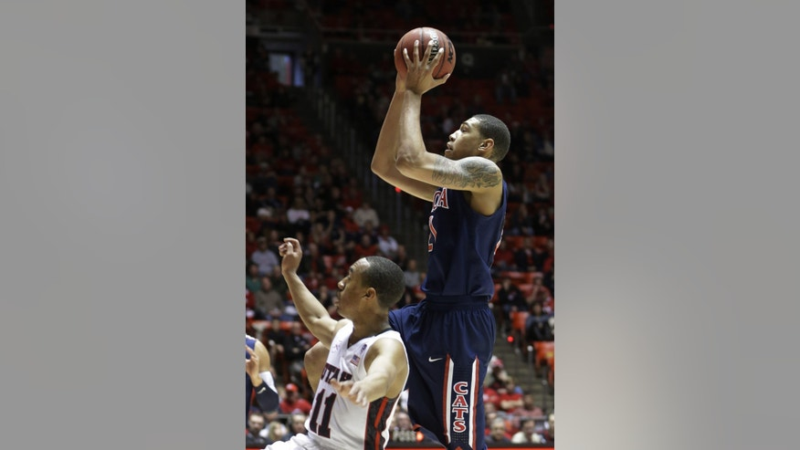 Arizona's Brandon Ashley, right, shoots as Utah's Brandon Taylor (11) defends in the second half during an NCAA college basketball game on Sunday, Feb. 17, 2013, in Salt Lake City. Arizona defeated Utah 68-64. (AP Photo/Rick Bowmer)