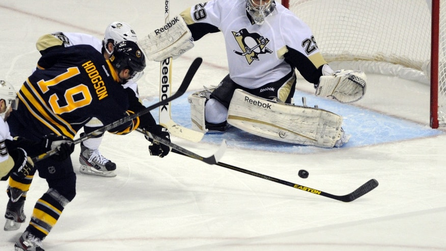 Buffalo Sabres' center Cody Hodgson (19) scores on Pittsburgh Penguins' goaltender Marc-Andre Fleury (29) during the first period of an NHL hockey game in Buffalo, N.Y., Sunday, Feb. 17, 2013. (AP Photo/Gary Wiepert)