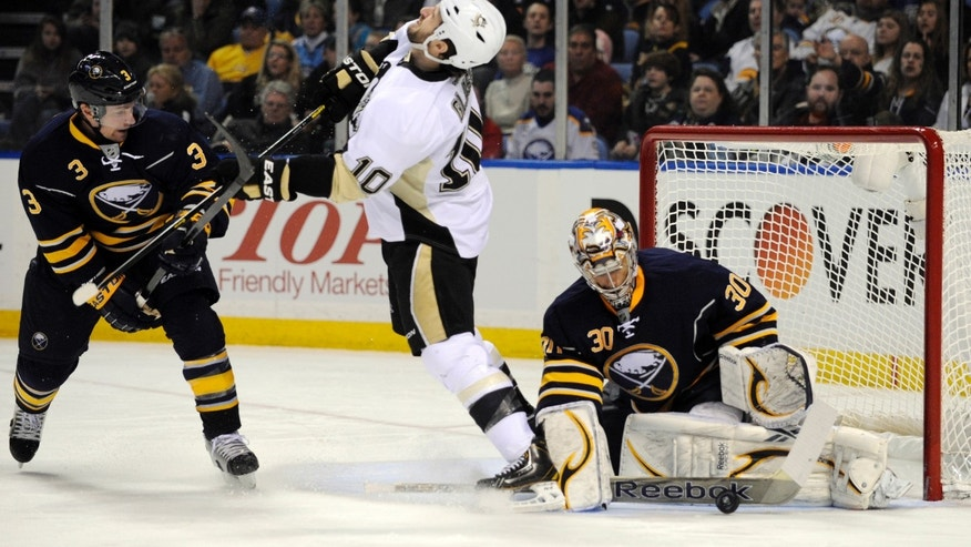 Buffalo Sabres' defenseman Jordan Leopold (3) gets his stick into the face of Pittsburgh Penguins left winger Tanner Glass (10) as Buffalo goaltender Ryan Miller (30) makes a save during the second period of an NHL hockey game in Buffalo, N.Y., Sunday, Feb. 17, 2013. (AP Photo/Gary Wiepert)