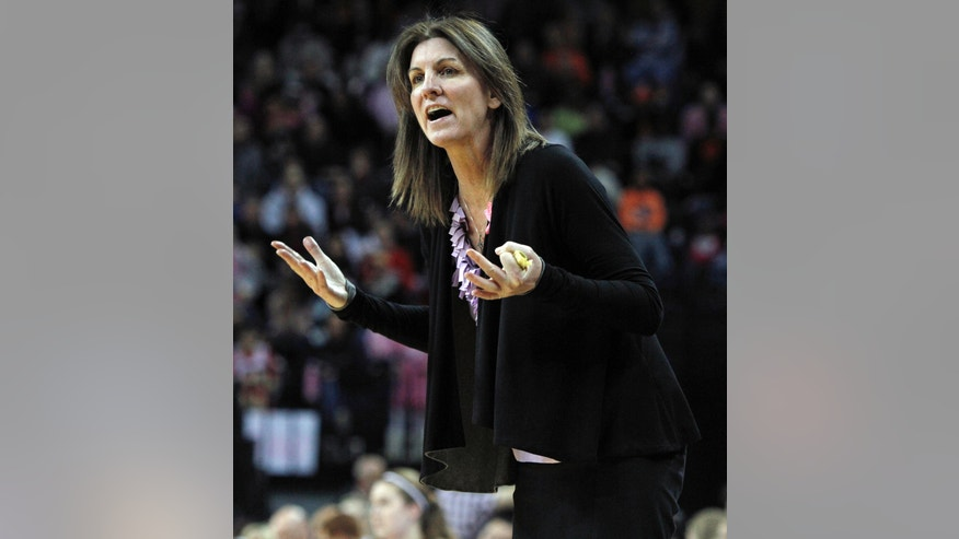 Virginia head coach Joanne Boyle yells about a missed call during the second half of an NCAA college basketball game against Maryland in Charlottesville, Va., Sunday, Feb. 17, 2013. Maryland defeated Virginia 73-44. (AP Photo/Norm Shafer)