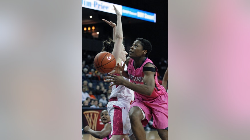 Maryland guard Katie Rutan tries to stop Virginia forward Sarah Imovbioh during the second half of an NCAA college basketball game in Charlottesville, Va., Sunday, Feb. 17, 2013. Maryland defeated Virginia 73-44.  (AP Photo/Norm Shafer)