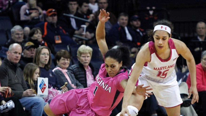 Virginia guard China Crosby tries to get control of the ball against Maryland guard Chloe Pavlech during the second half of an NCAA college basketball game in Charlottesville, Va., Sunday, Feb. 17,  2013.  Maryland defeated Virginia 73-44. (AP Photo/Norm Shafer)