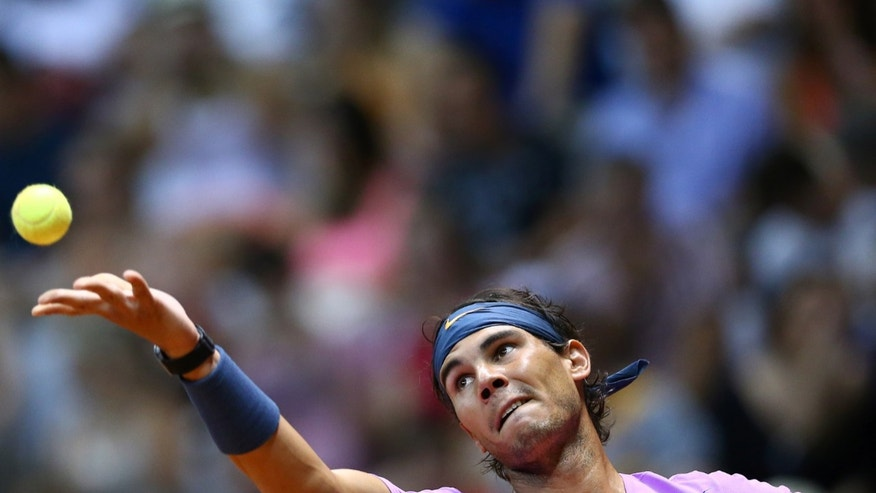 Spain's Rafael Nadal serves to Argentina's David Nalbandian during the Brazil Open ATP tournament final match in Sao Paulo, Brazil, Sunday, Feb. 17, 2013. (AP Photo/Andre Penner)
