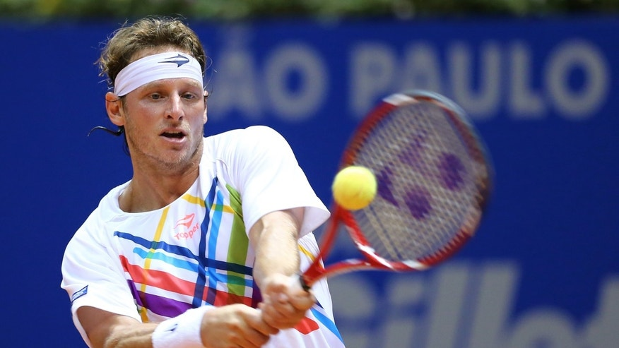 Argentina's David Nalbandian returns the ball to Spain's Rafael Nadal  during the Brazil Open ATP tournament final  match in Sao Paulo, Brazil, Sunday, Feb. 17, 2013. (AP Photo/Andre Penner)