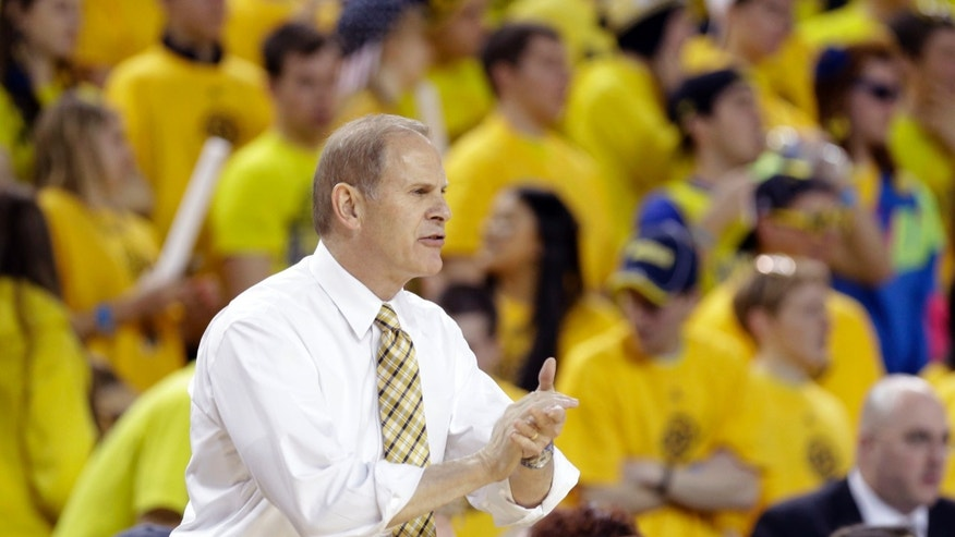 Michigan head coach John Beilein directs from the sidelines during the first half of an NCAA college basketball game against Penn State at Crisler Center in Ann Arbor, Mich., Sunday, Feb. 17, 2013. (AP Photo/Carlos Osorio)