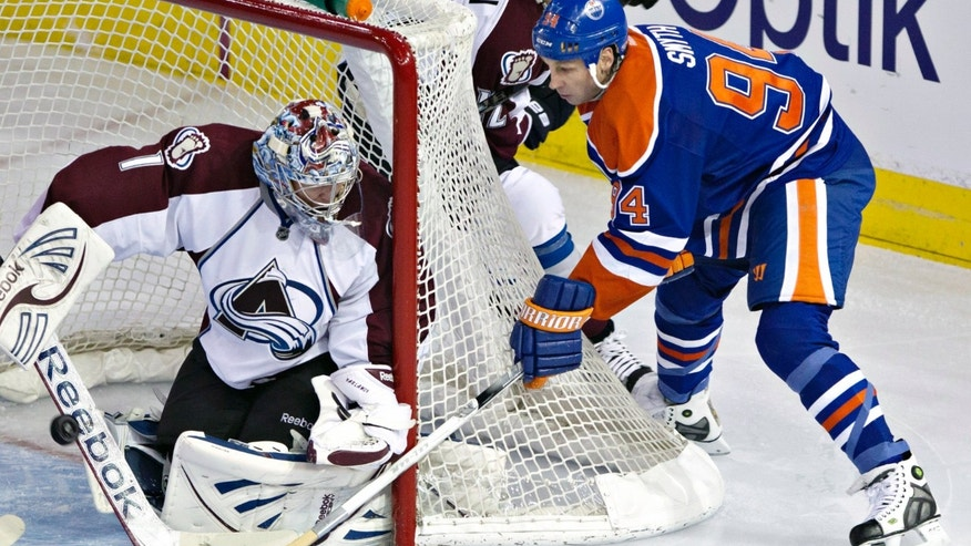 Colorado Avalanche goalie Semyon Varlamov makes the save on Edmonton Oilers' Ryan Smyth during the second period of an NHL hockey game in Edmonton, Alberta, Saturday, Feb. 16, 2013. (AP Photo/The Canadian Press, Jason Franson)