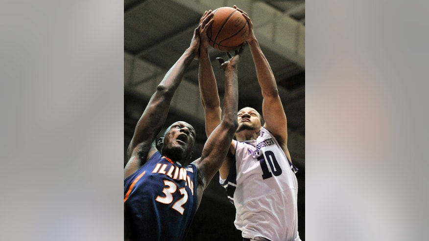 Illinois' Nnanna Egwu (32) battles Northwestern's Mike Turner (10) for a rebound during the first half of an NCAA college basketball game in Evanston, Ill., Sunday, Feb. 17, 2013. (AP Photo/Paul Beaty)