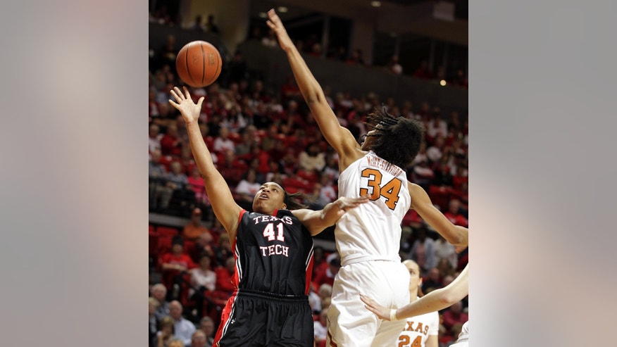 Texas Tech's Kelsi Baker (41) shoots against Texas' Imani McGee-Stafford during their NCAA college basketball game in Lubbock, Texas, Sunday, Feb. 17, 2013. (AP Photo/The Avalanche-Journal, Zach Long) ALL LOCAL TV OUT