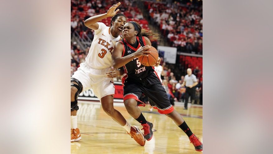 Texas Tech's Christine Hyde, right, drives against Texas' Nneka Enemkpali during their NCAA college basketball game in Lubbock, Texas, Sunday, Feb. 17, 2013. (AP Photo/The Avalanche-Journal, Zach Long) ALL LOCAL TV OUT