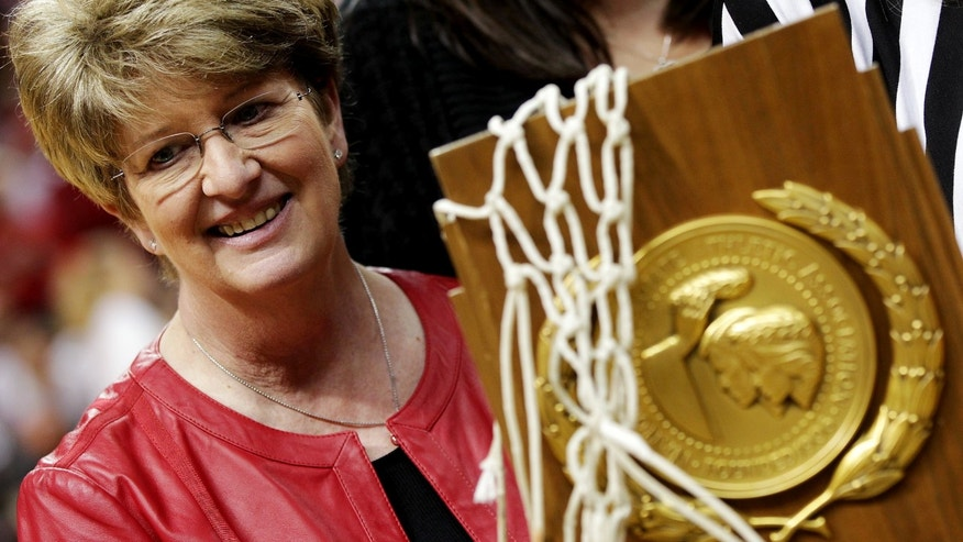 Marsha Sharp smiles during a ceremony to honor the 1993 Texas Tech national championship team at an NCAA college basketball game between Texas Tech and Texas in Lubbock, Texas, Sunday, Feb. 17, 2013. (AP Photo/The Avalanche-Journal, Zach Long) ALL LOCAL TV OUT