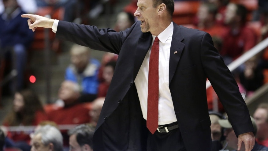 Utah head coach Larry Kryskowiak shouts to his team in the first half during an NCAA college basketball game against Arizona, Sunday, Feb. 17, 2013, in Salt Lake City. (AP Photo/Rick Bowmer)