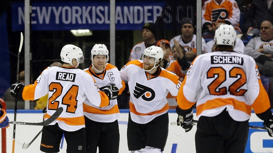 Philadelphia Flyers' Claude Giroux, second from left, celebrates his goal with teammates Matt Read, left, Jakub Voracek, second from right, and Luke Schenn (22) during the second period of the NHL hockey game against the New York Islanders Monday, Feb. 18, 2013, in Uniondale, N.Y. (AP Photo/Seth Wenig)