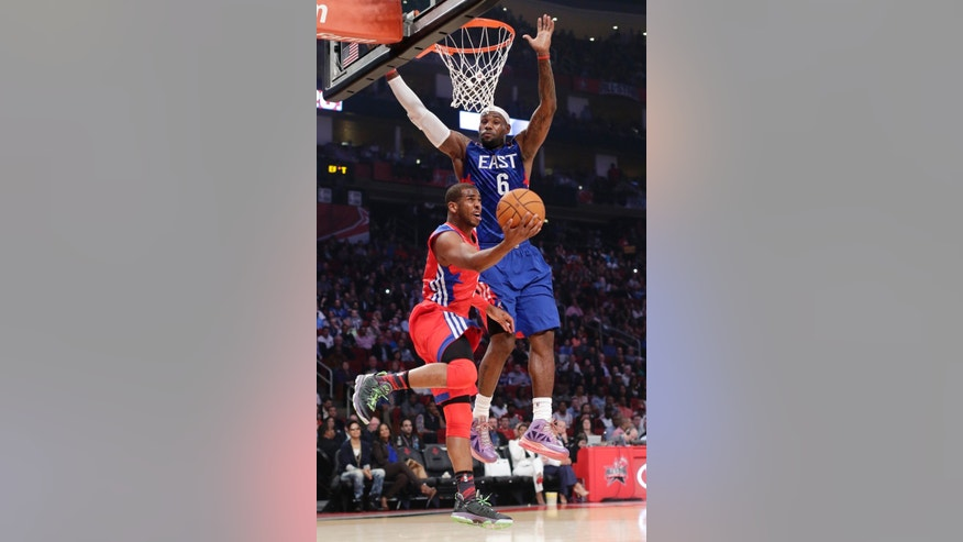 West Team's Chris Paul of the Los Angeles Clippers shoots against East Team's LeBron James of the Miamia Heat during the first half of the NBA All-Star basketball game Sunday, Feb. 17, 2013, in Houston. (AP Photo/Eric Gay)