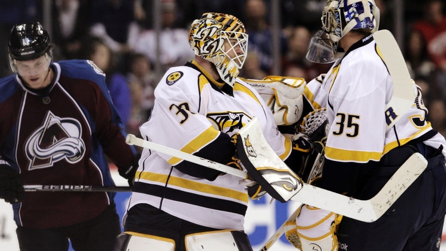 Nashville Predators goalie Chris Mason (30) is replaced by goalie Pekka Rinne (35), of Finland, during the second period of an NHL hockey game against the Colorado Avalanche, Monday, Feb. 18, 2013, in Denver. (AP Photo/Joe Mahoney)