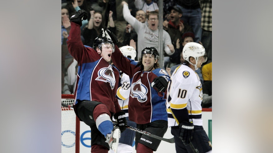 Colorado Avalanche left wing Jamie McGinn (11) celebrates his goal with Avalanche right wing P.A. Parenteau (15) during the second period of an NHL hockey game against the Nashville Predators, Monday, Feb. 18, 2013, in Denver. Predators left wing Martin Erat (10), of the Czech Republic, skates away. (AP Photo/Joe Mahoney)