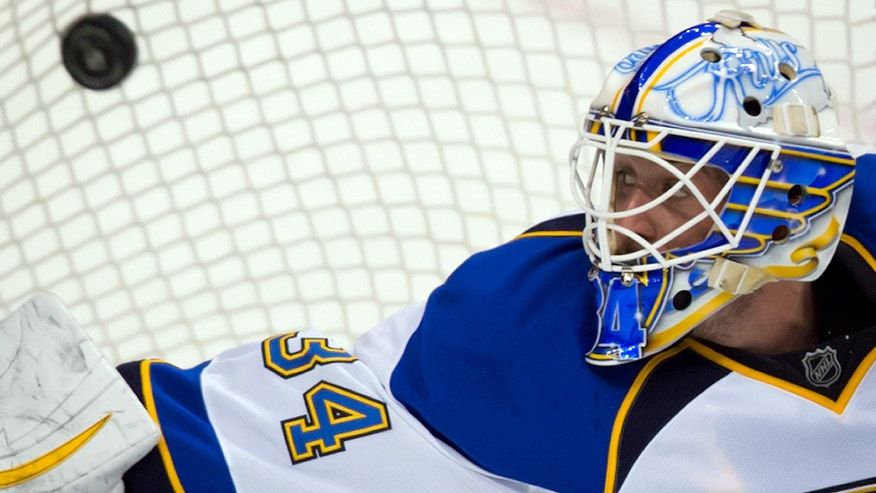 St. Louis Blues' goalie Jake Allen can't stop a goal by Vancouver Canucks' Mason Raymond, unseen, during the third period of an NHL hockey game in Vancouver, British Columbia, on Sunday, Feb. 17, 2013. (AP Photo/The Canadian Press, Darryl Dyck)
