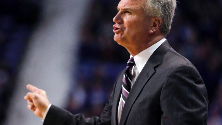 Kansas State head coach Bruce Weber directs his team during the first half of an NCAA college basketball game against West Virginia in Manhattan, Kan., Monday, Feb. 18, 2013. (AP Photo/Orlin Wagner)