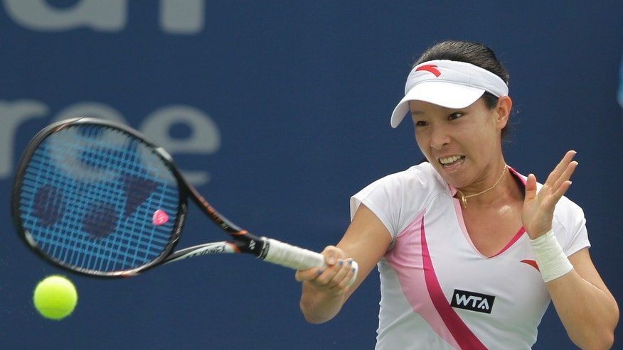 Jie Zheng of China returns the ball to Russia's Ekaterina Bychkova during the first day of Dubai Duty Free Tennis Championships in Dubai, United Arab Emirates, Monday, Feb. 18, 2013. (AP Photo/Kamran Jebreili)