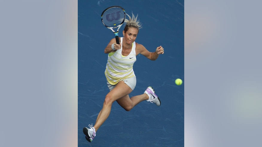Karla Zakopalova of Czech Republic returns the ball to Marion Bartoli of France during the first day of the Dubai Duty Free Tennis Championships in Dubai, United Arab Emirates, Monday, Feb. 18, 2013. (AP Photo/Kamran Jebreili)