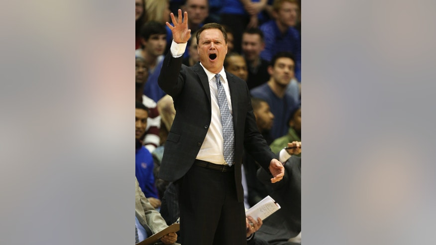 Kansas head coach Bill Self calls out plays to his players during the first half of an NCAA college basketball game against Texas, Saturday, Feb. 16, 2013, in Lawrence, Kan. Kansas won 73-47. (AP Photo/Ed Zurga)