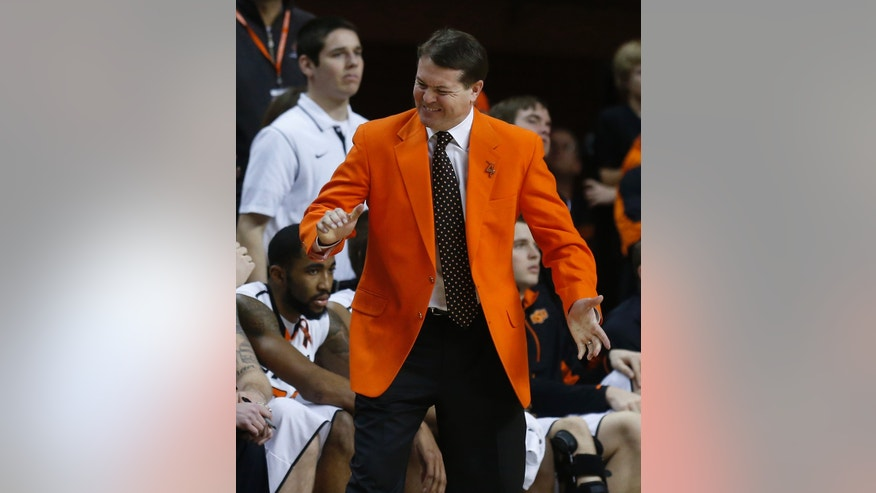 Oklahoma State head coach Travis Ford gestures during the second half of an NCAA college basketball game against Oklahoma in Stillwater, Okla., Saturday, Feb. 16, 2013. Oklahoma State won 84-79. (AP Photo/Sue Ogrocki)