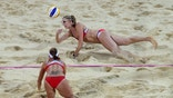 LONDON, ENGLAND - AUGUST 08:  Kerri Walsh Jennings (top) of the United States dives for the ball during the Women's Beach Volleyball Gold medal match against the United States on Day 12 of the London 2012 Olympic Games at the Horse Guard's Parade on August 8, 2012 in London, England.  (Photo by Ryan Pierse/Getty Images)