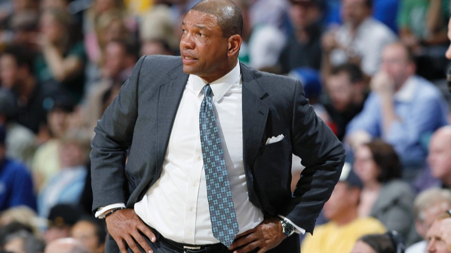 Boston Celtics coach Doc Rivers reacts to a Celtics turnout in the first quarter of an NBA basketball game against the Denver Nuggets in Denver on Tuesday, Feb. 19, 2013. (AP Photo/David Zalubowski)