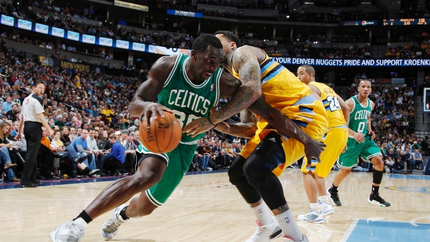 Boston Celtics forward Brandon Bass works ball inside past Denver Nuggets forward Wilson Chandler during the first quarter of an NBA basketball game in Denver on Tuesday, Feb. 19, 2013. (AP Photo/David Zalubowski)
