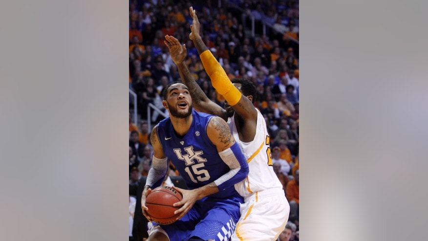 Kentucky forward Willie Cauley-Stein (15) works against Tennessee forward Kenny Hall (20) in the first half of an NCAA college basketball game on Saturday, Feb. 16, 2013, in Knoxville, Tenn. (AP Photo/Wade Payne)