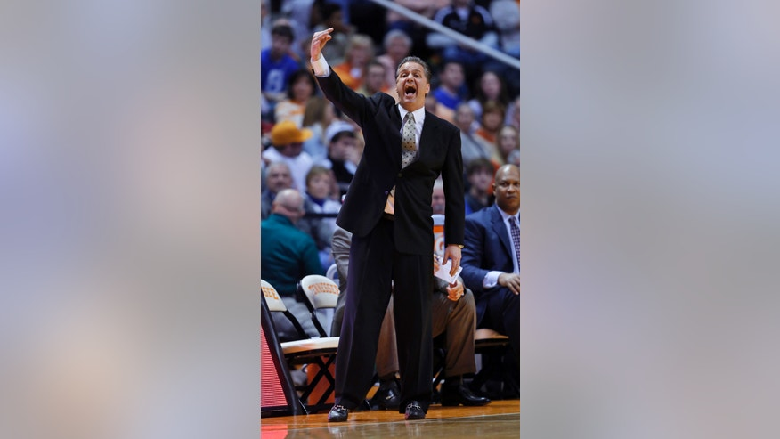 Kentucky head coach John Calipari directs his team in the first half of an NCAA college basketball game against Tennessee on Saturday, Feb. 16, 2013, in Knoxville, Tenn. Tennessee won 88-58. (AP Photo/Wade Payne)
