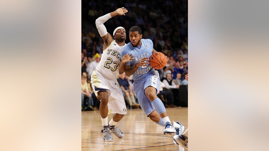 North Carolina guard Leslie McDonald (2) drives against Georgia Tech guard Brandon Reed (23) during the first half of an NCAA college basketball game Tuesday, Feb. 19, 2013, in Atlanta. (AP Photo/John Bazemore)