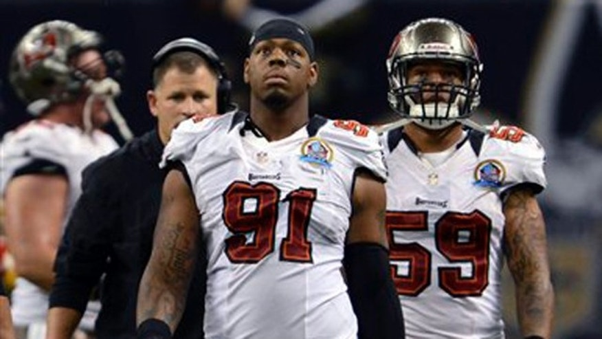 Dec. 16, 2012: Tampa Bay Buccaneers defensive end Da&#39&#x3b;Quan Bowers (91) walks off the field during an NFL football game in New Orleans.