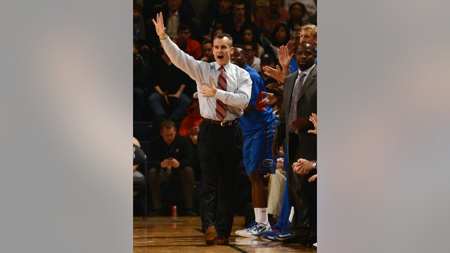 Florida coach Billy Donovan calls in a play to his team in the first half of an NCAA college basketball game against Auburn on Saturday, Feb. 16, 2013 in Auburn, Ala. (AP Photo/Todd J. Van Emst)